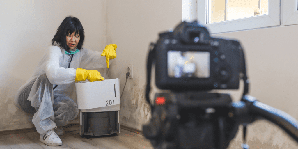 A girl showing how to clean a dehumidifier